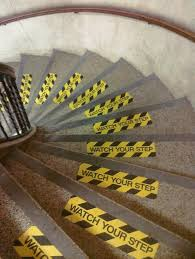 Seeing all those safety stickers would making anyone using the stairs dizzy enough to fall down them